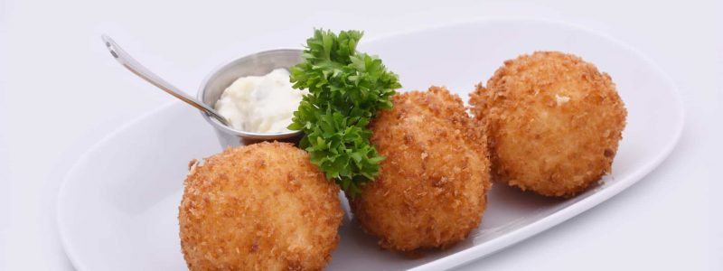 Cheese Balls. Deep fried cheese balls prepared from cow milk cheese with special butter.  On a white background